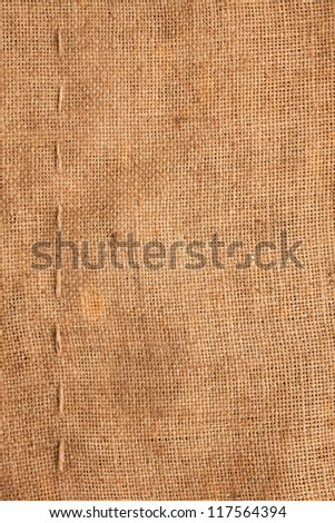Line, guy-sutures on  Burlap ,sacking, it is possible to use as a background - stock photo