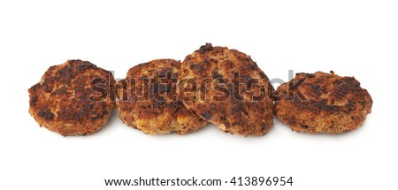 Line made of prepared small hand made cutlets isolated over white background - stock photo