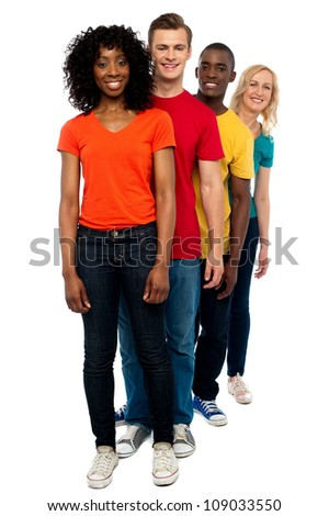 Line of casual friends dressed in colorful attires standing behind one another