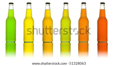 Line of cold and wet glass bottles in different color on white background