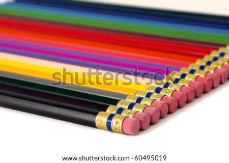 Line of colored pencils at an angle, on white - stock photo