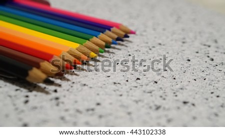 line of colored pencils,Color pencil with copy space isolated on whtie and black dot background,education frame concept.Crayons. Colored Pencils. colored pencils on white background and wood chips - stock photo