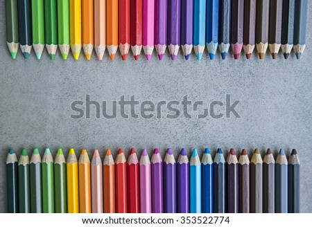 Line of colored pencils, Colour pencils on gray tile surface background close up - copy space & Your text design - stock photo