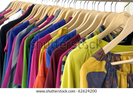 Line of colorful shirt rack on white