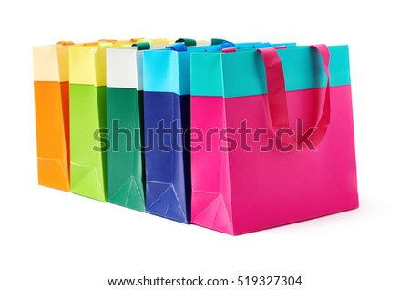 Line of colorful shopping or gift bags isolated over the white background