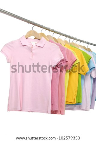 Line of colorful t-shirt rack - stock photo