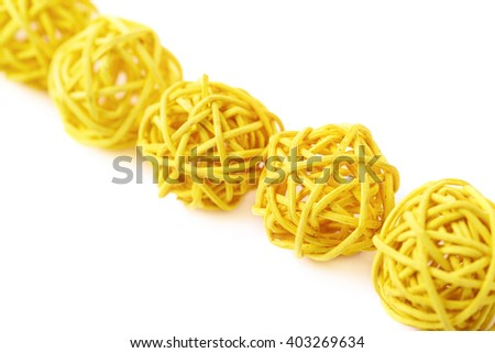 Line of decorative colored straw balls isolated over the white background