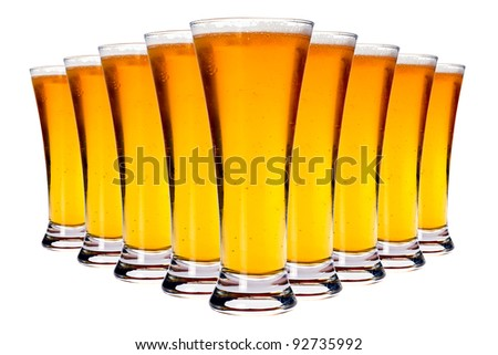 Line of glasses with lager beer isolated on white - stock photo