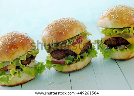 Line of hamburgers on a light blue background.