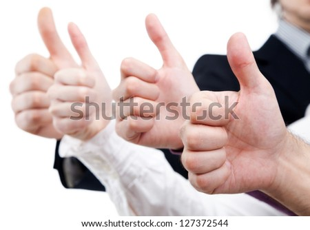 Line of hands of business team thump up together - stock photo