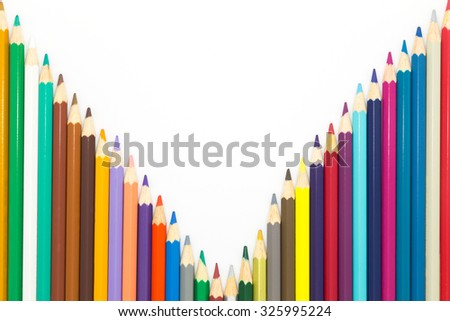 Line of mixed colours wooden pencil on white background - stock photo