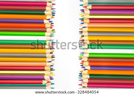 Line of multiple colour wooden pencils on white background