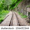 Line of railway crossing near the mountain in rural of Thailand. - stock photo