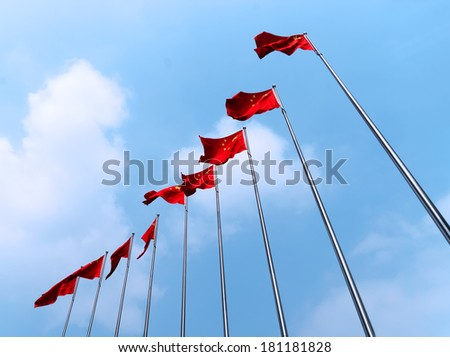 Line of red Chinese flags, symbol of communism - stock photo