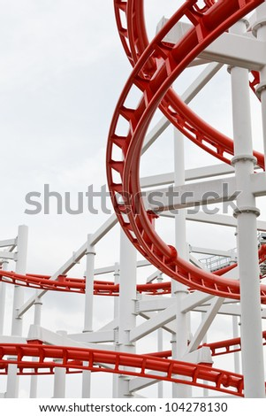 Line of red roller coaster rail - stock photo