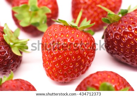 Line of red strawberries isolated