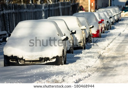 Line of Snow-Covered Cars. - stock photo