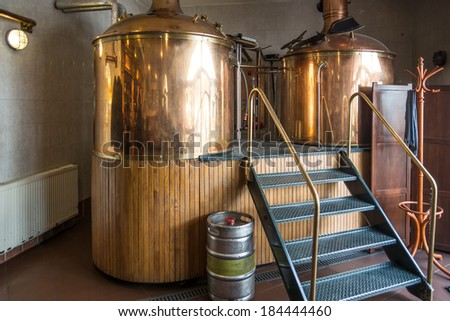Line of two traditional brewing vessels in brewery. - stock photo