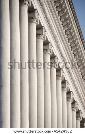 Line of white ionic columns with soft shadows