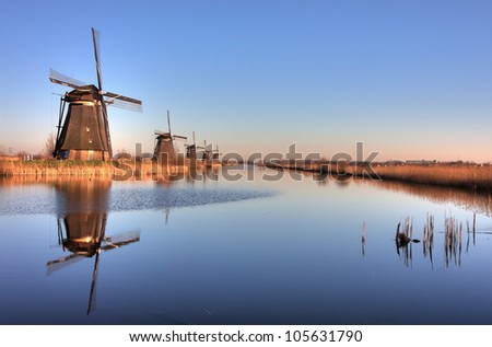 Line of Windmills reflection in Holland. Kinderdijk - stock photo