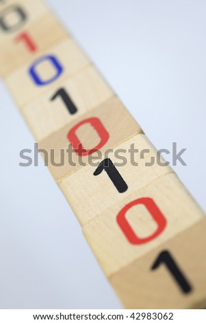 Line of Wooden Blocks with binary code on White Background - stock photo