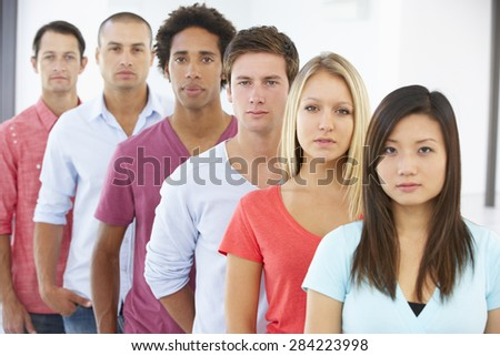 Line Of Young Business People In Casual Dress - stock photo