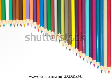 Lined of colours wooden pencils on white background - stock photo