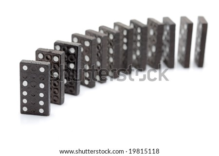 Lined up dominoes isolated against white background