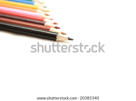 Lined up pencils of different colours lined up against a white background. Great art, craft and schooling background