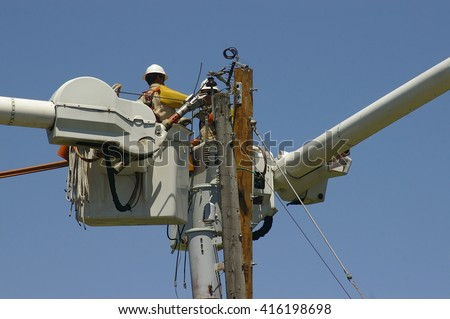 Linemen replacing old utility pole - stock photo