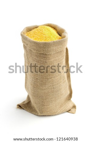 linen bag with corn flour isolated on white background - stock photo