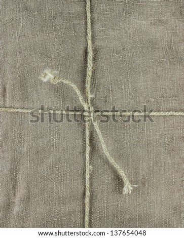Linen cloth tied up with ropes background - stock photo