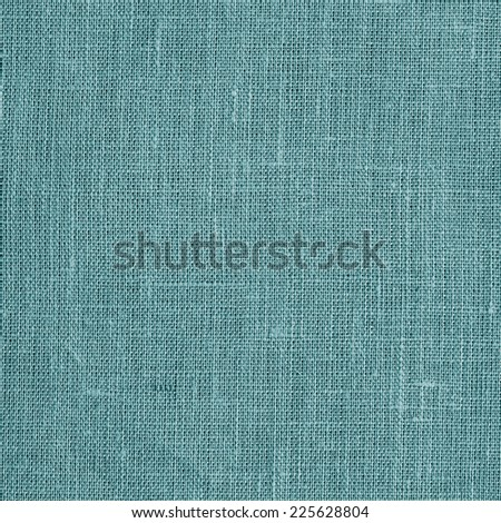Linen coarse natural woven blue canvas fabric texture for the background - stock photo