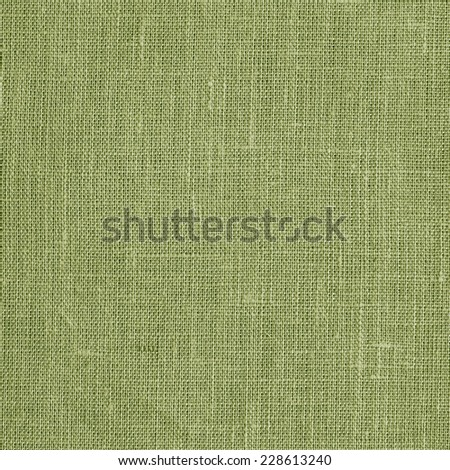Linen coarse natural woven green canvas fabric texture for the background - stock photo