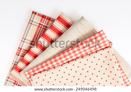 Linen fabric accessories for decoration and  for needlework stacked in pile isolated. Unique perspectives top view. - stock photo