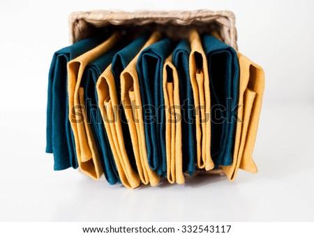 Linen napkins stack isolated in storage box