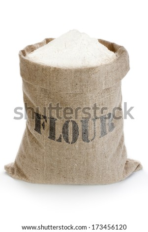 Linen sack full of flour isolated on white background - stock photo