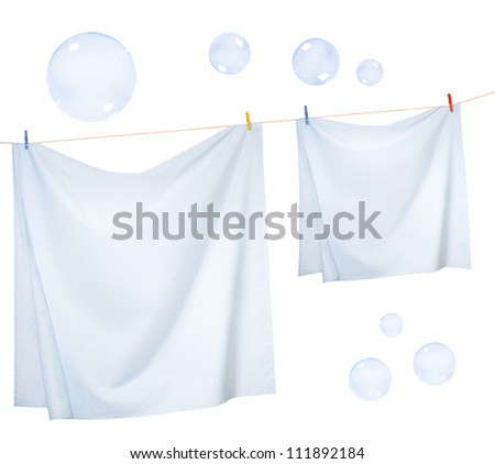 Linen sheets drying on a rope and Soap bubbles, isolated on a white background - stock photo