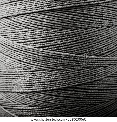 lines and geometry in black and white photography, the structure of the rope in the bobbin, the thread industry natralny - stock photo