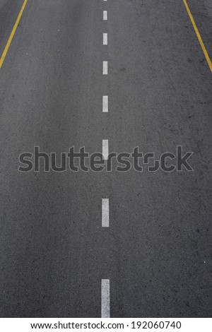 Lines and lane markings on the on asphalt road surface texture - stock photo