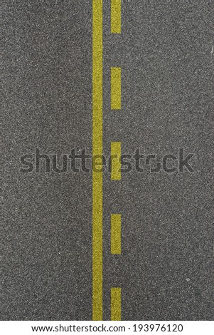 Lines and lane markings on the on asphalt road surface texture
