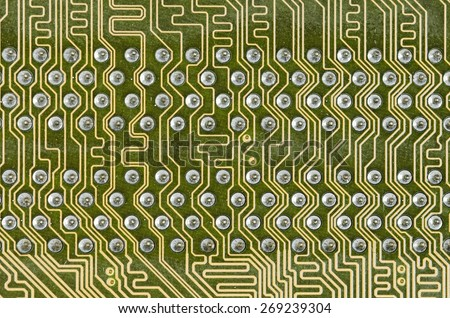 lines and solder joints of the modern circuit board - stock photo