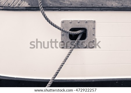 Lines emerging from side port on fishing boat