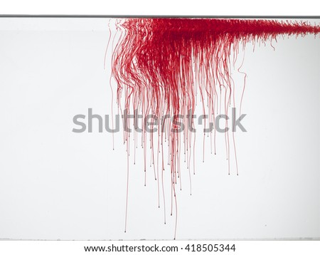 Lines of blood or red color in water, isolated on white background.  - stock photo