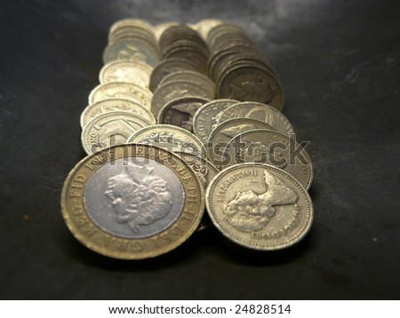 lines of british pounds in a metal dish
