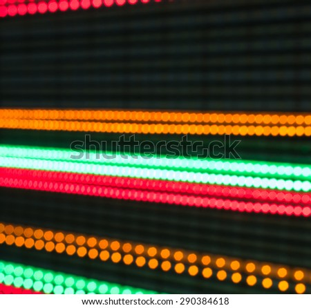 Lines of multicolored LED lights defocused bokeh style - stock photo