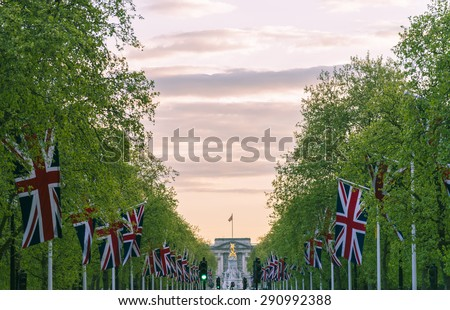 Lines of union jack flags hanging along the Mall, London - stock photo