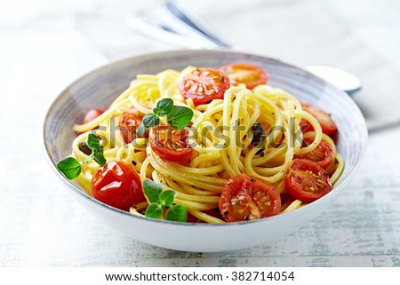 Linguine with cherry tomatoes and herbs - stock photo