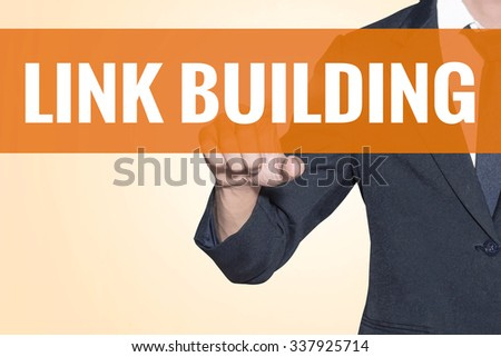 Link Building word Business man touch on virtual screen orange background - stock photo