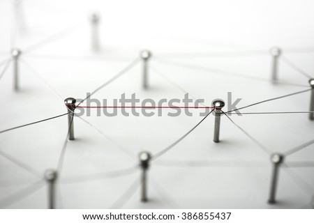 Linking entities. Hotline, high bandwidth.  Network, networking, social media, connectivity, internet communication abstract. Single red wire in a web of silver wires on white background.